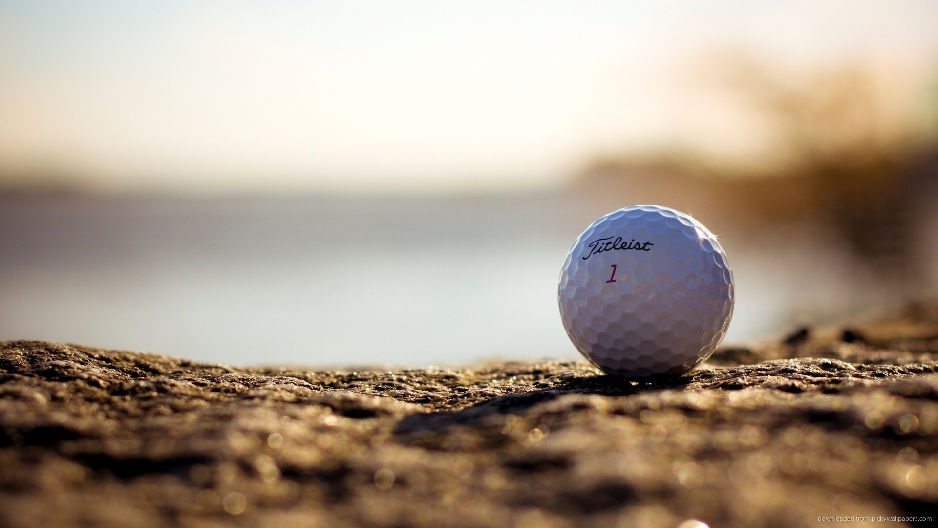 golf ball on a rocky surface